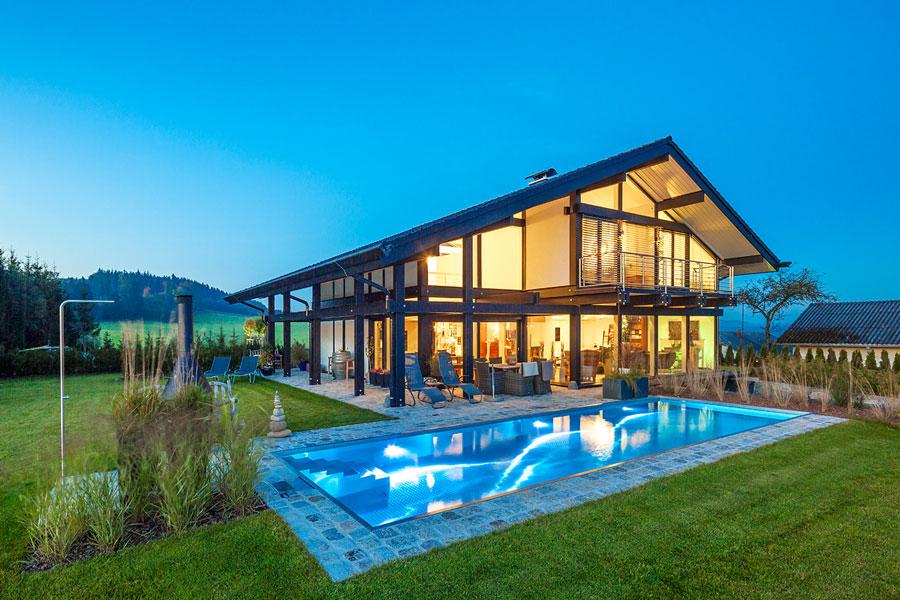 Realizzazione casa in legno vetro ticino flock haus for Case in vetro